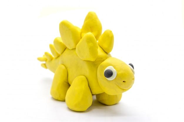 Jouer la pâte stegosaurus sur fond blanc Photo Premium