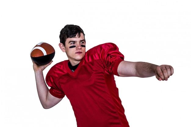 Joueur de football américain lancer une balle Photo Premium
