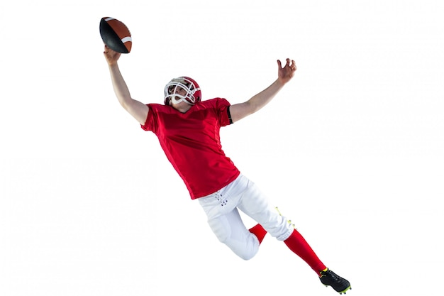 Joueur de football américain marquant un touché Photo Premium