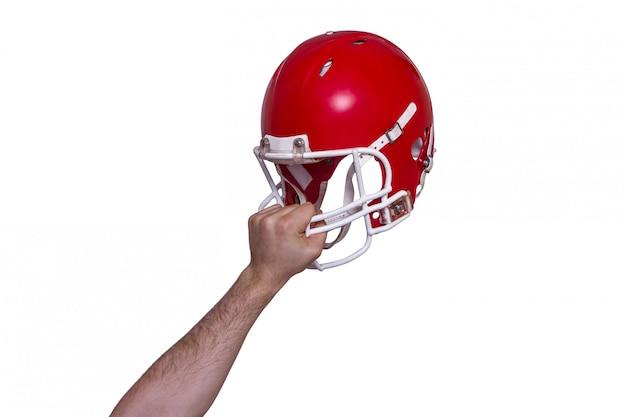 Joueur de football américain remettant son casque Photo Premium