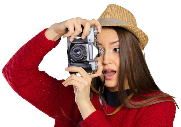 Joyeuse jeune femme avec caméra Photo Premium