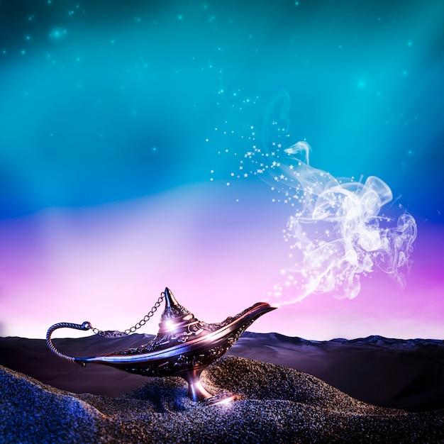 Lampe aladdin dans le désert Photo Premium