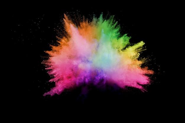 Lancé poudre colorée. explosion de poudre de couleur. éclaboussures de poussière colorées. Photo Premium
