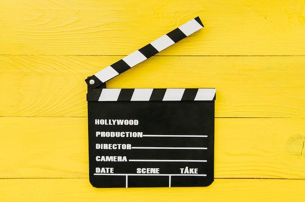 Lay plat de clap pour le concept de cinéma Photo gratuit