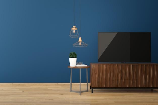 Led tv sur le sol en bois mur bleu Photo Premium