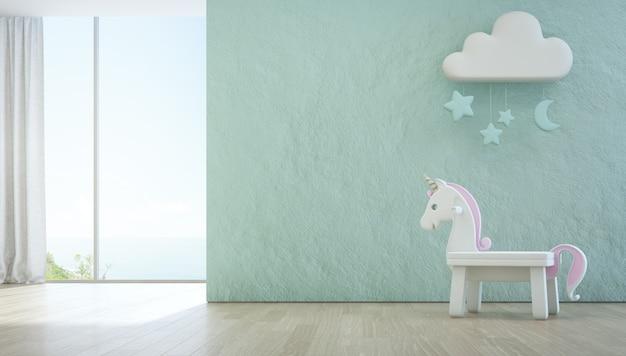 Licorne blanche sur plancher en bois de chambre d'enfant vue mer. Photo Premium