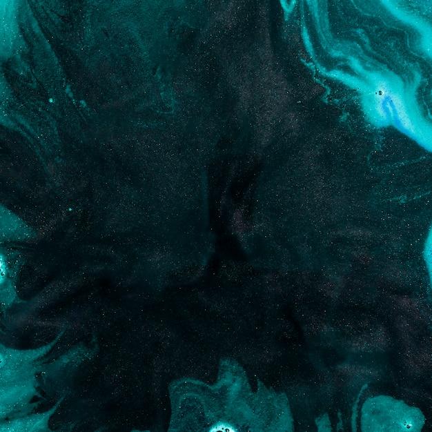Liquide noir avec mousse d'azur Photo gratuit