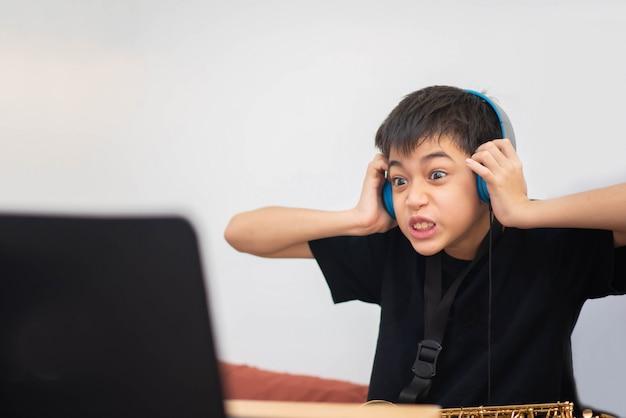 Little Asian Boy Study Saxophone Instument Music Online At Home Photo Premium