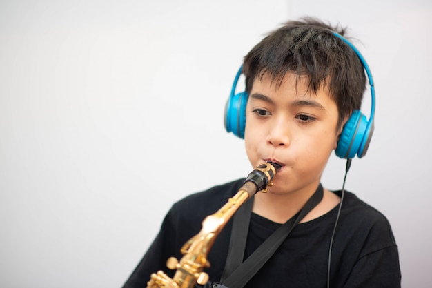 Little Asian Boy Study Saxophone Instument Music Online At Home Photo Premium