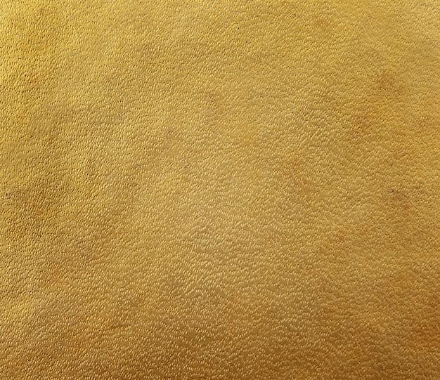 Livre à couverture rigide marron doré, texture papier Photo Premium