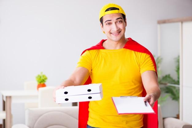 Livreur de pizza super-héros avec couvercle rouge Photo Premium