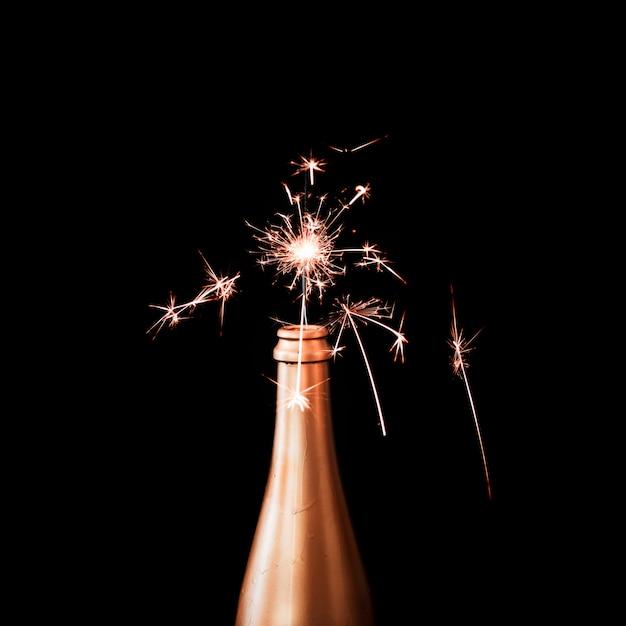 Lumière du bengale en bouteille de champagne Photo gratuit