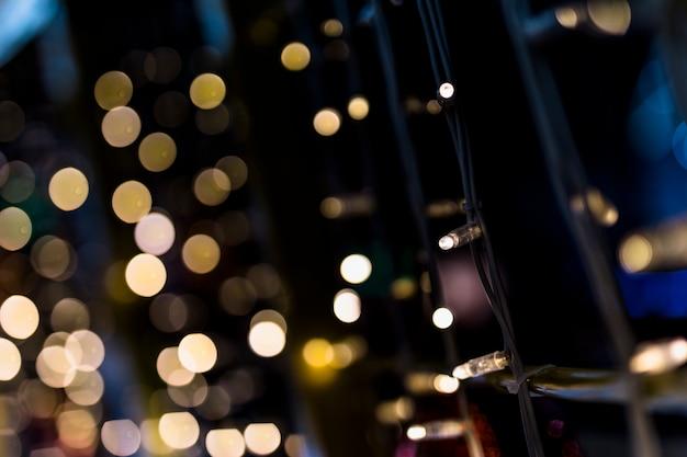 Lumière de fée sur fond de bokeh doré Photo gratuit