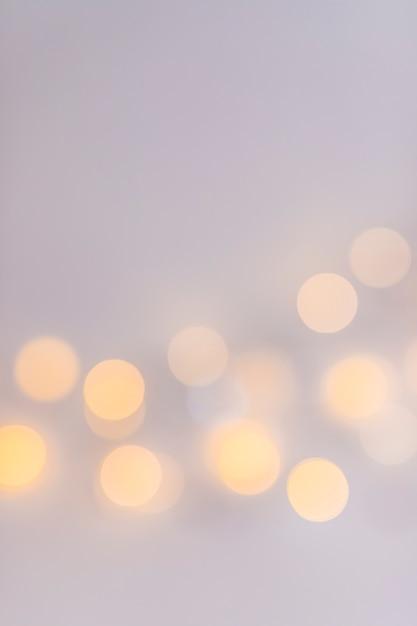 Lumières abstraites sur fond gris Photo gratuit
