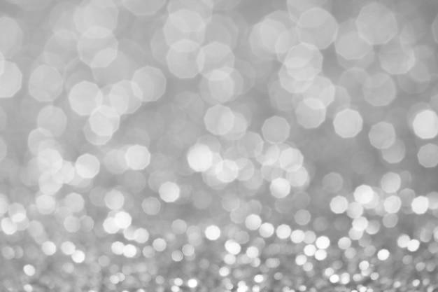 Lumières de bokeh grises et blanches défocalisées. abstrait Photo Premium