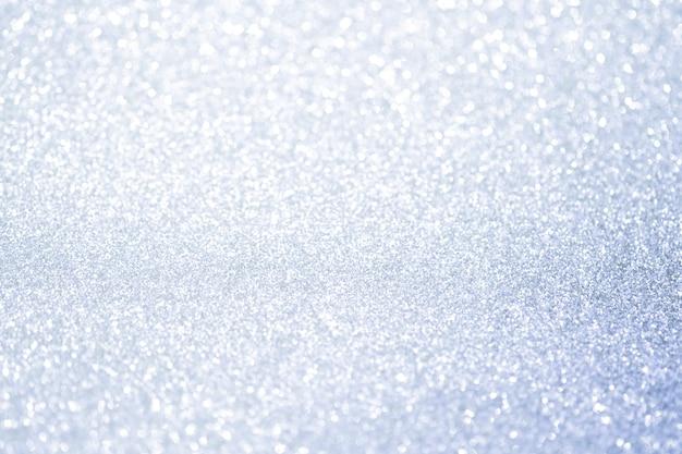 Lumières de bokeh de paillettes argent abstraites avec fond clair et doux. Photo Premium