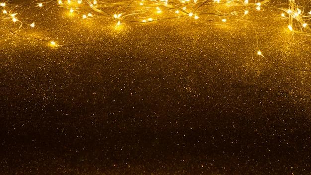 Lumières de noël sur fond de paillettes Photo Premium
