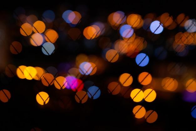 Lumières De La Ville De Bokeh Sur Fond Noir Photo Premium