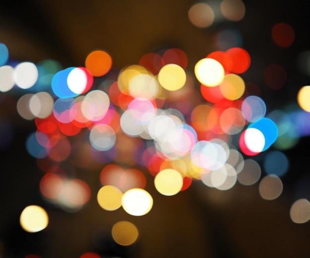 Lumières de la ville de nuit fond coloré bokeh, concept de ténèbres Photo Premium