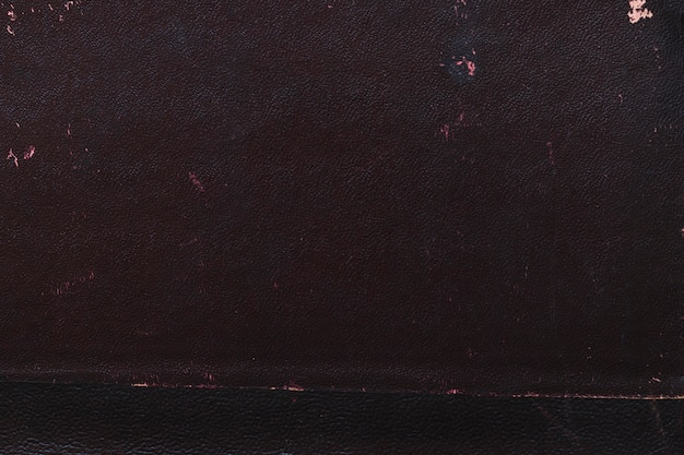 Macro photo d'une texture de couverture de livre noir ancien Photo gratuit