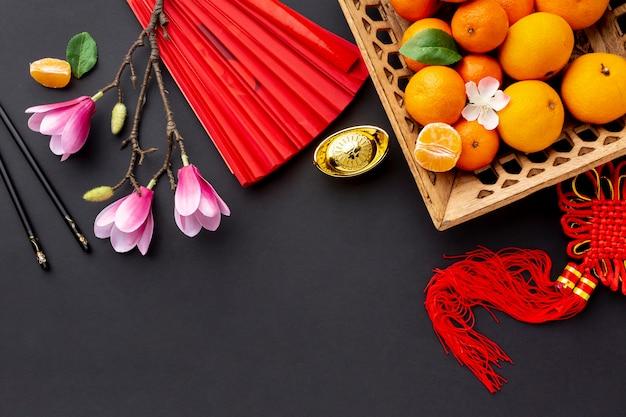 Magnolia Et Panier De Mandarine Nouvel An Chinois Photo gratuit