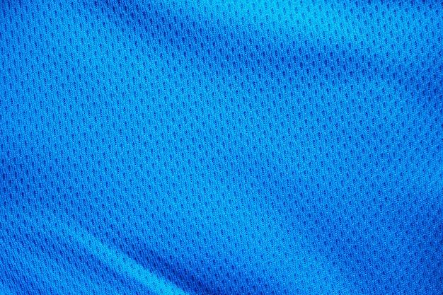 Maillot De Football De Vêtements De Sport En Tissu Bleu Avec Fond De Texture De Maille D'air Photo Premium