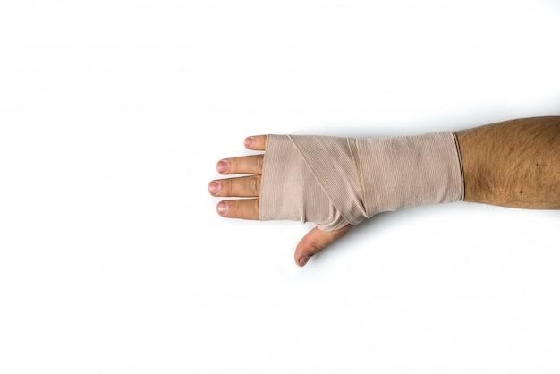Main bandée de l'homme sur fond isolé blanc Photo Premium