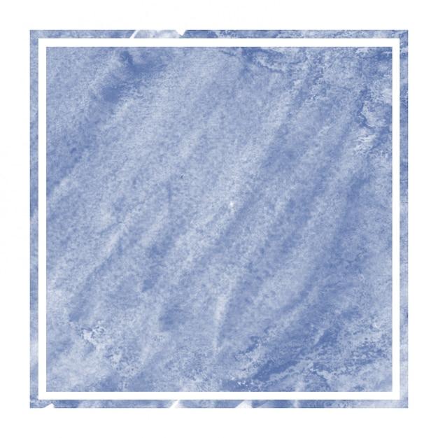 Main bleu foncé dessiné texture d'arrière-plan aquarelle cadre rectangulaire avec des taches Photo Premium