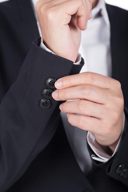 La main en costume noir s'habille Photo Premium
