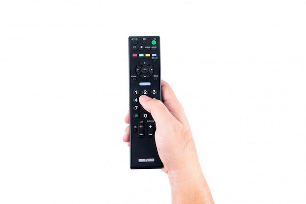 Main de l'homme asiatique tenant une télécommande de télévision dans les mains sur fond blanc ou isolé Photo Premium