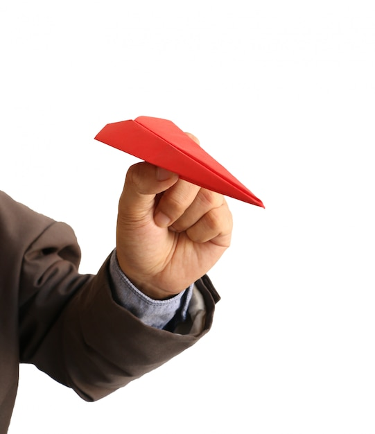 Main De L'homme Tenant Un Avion En Papier Rouge Photo Premium