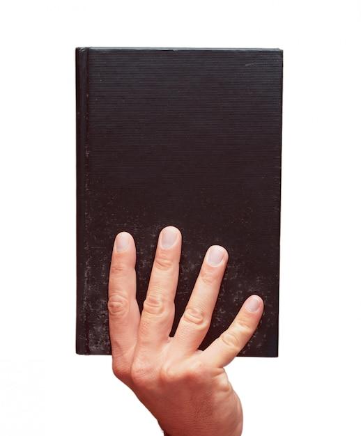 Main mâle isolé, tenant un livre Photo Premium