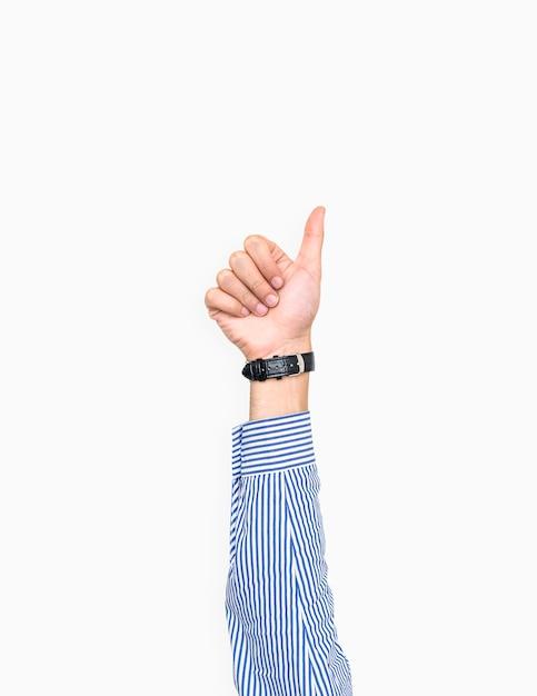 Main montrant le geste du pouce levé Photo gratuit