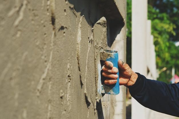 Main, Ouvrier, Plâtrer, Ciment, Sur, Mur Photo Premium
