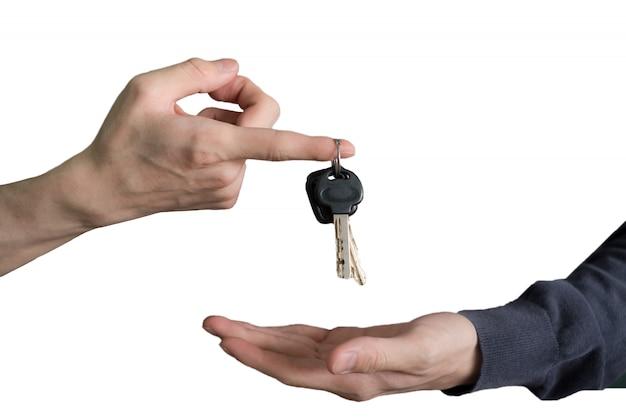 Main, remettre, clés voiture, à, doigt, main, réception Photo Premium