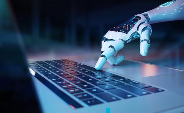 Main robotique appuyant sur un clavier sur un ordinateur portable Photo Premium