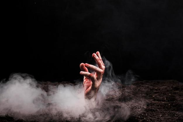 Main sortant du sol Photo gratuit