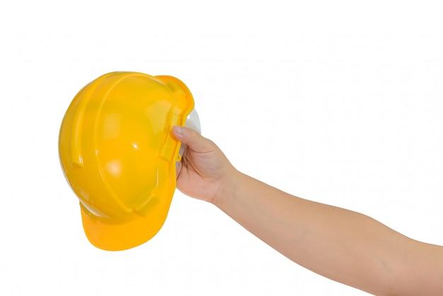 Main tenant un casque, casque isolé Photo Premium