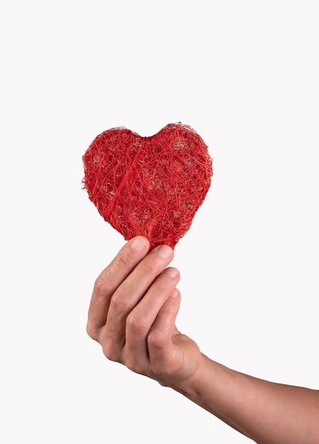 Main Tenant Un Coeur Entre Les Doigts Concept De La Saint-valentin Photo Premium