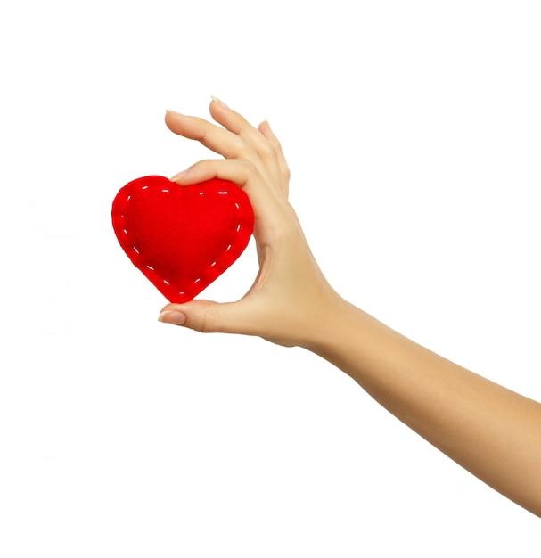 Main tenant un coeur isolé Photo Premium