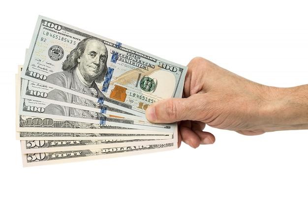 Main Tenant Des Dollars En Argent, Isolé Sur Blanc Photo Premium