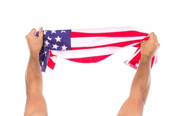 Une main tenant le drapeau américain isolé sur fond blanc Photo gratuit