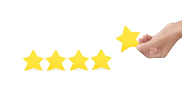 Main Tenant Une étoile Jaune. Augmenter L'évaluation Des Notes Et Le Concept De Classification Photo Premium