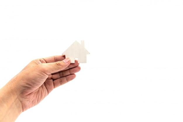 Main tenant l'icône de la maison blanche Photo Premium