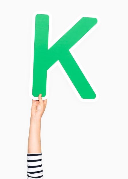 Main tenant la lettre k Photo gratuit