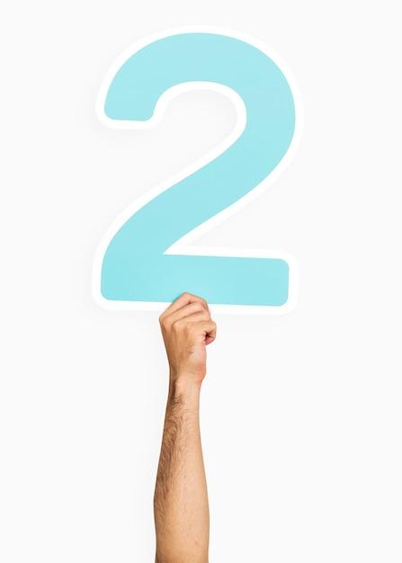 Main tenant le numéro 2 Photo gratuit