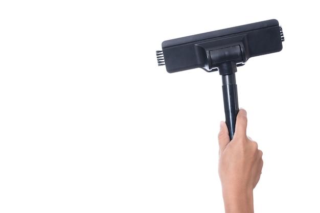 Main tenant la tête du dispositif de nettoyage de la balayeuse de l'aspirateur Photo Premium