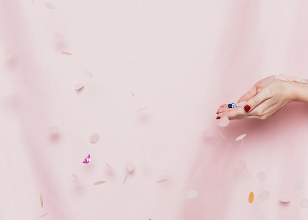 Mains, confetti, devant, textile Photo gratuit