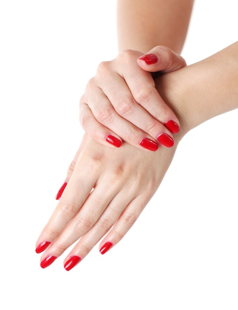 Mains De Femme Avec Manucure Rouge Photo gratuit
