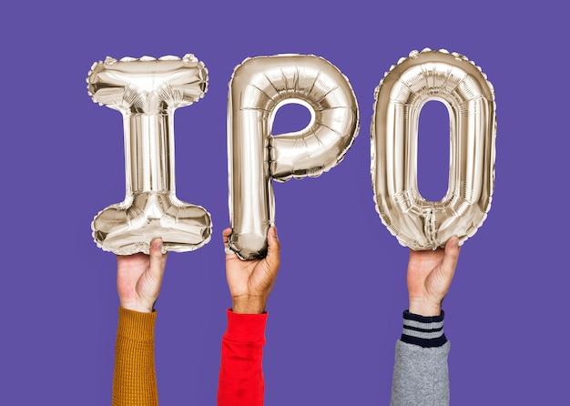 Mains, mot, introduction en bourse, en lettres ballon Photo Premium
